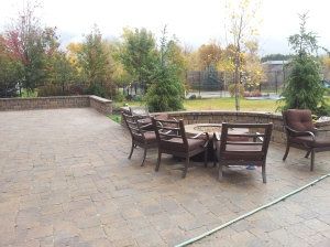Natural gas fire pit in the landscaping done in pavers