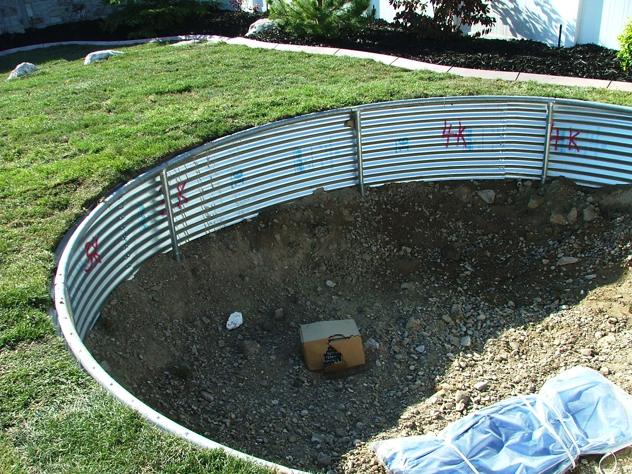 in the ground metal ring for a trampoline in south jordan utah chris jensen landscaping in. Black Bedroom Furniture Sets. Home Design Ideas