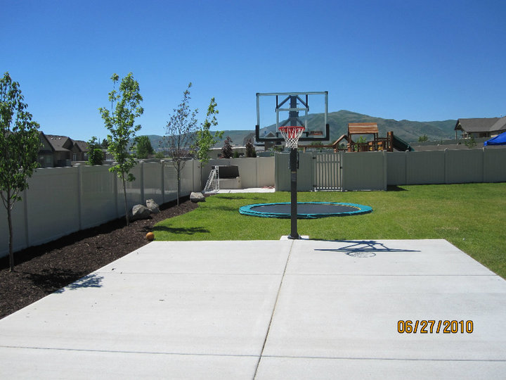 After backyard landscaping sports court and trampoline in for Sport court utah