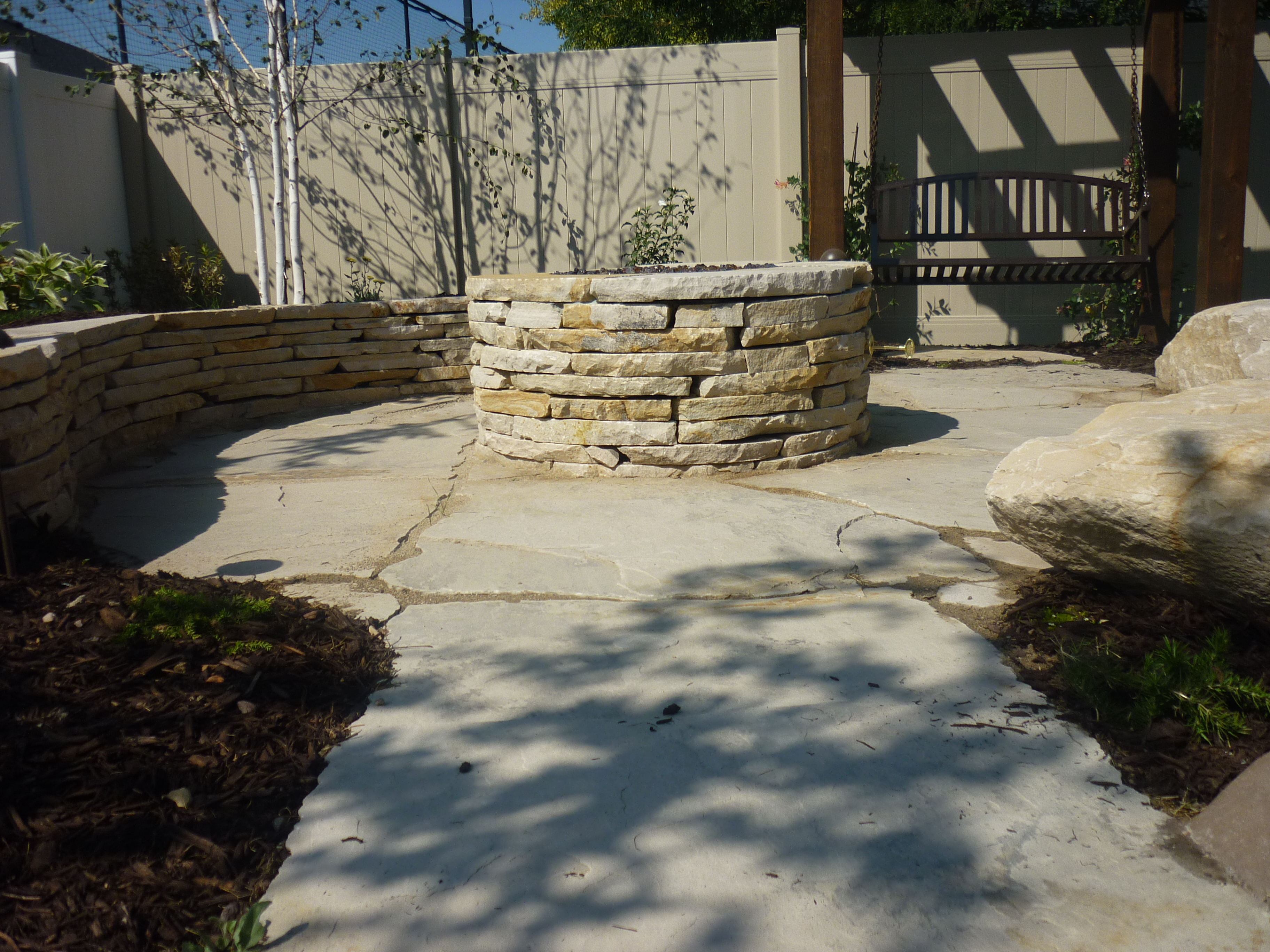 Utah fire pits that are custom in real flagstone rock from for Landscaping rocks in salt lake city