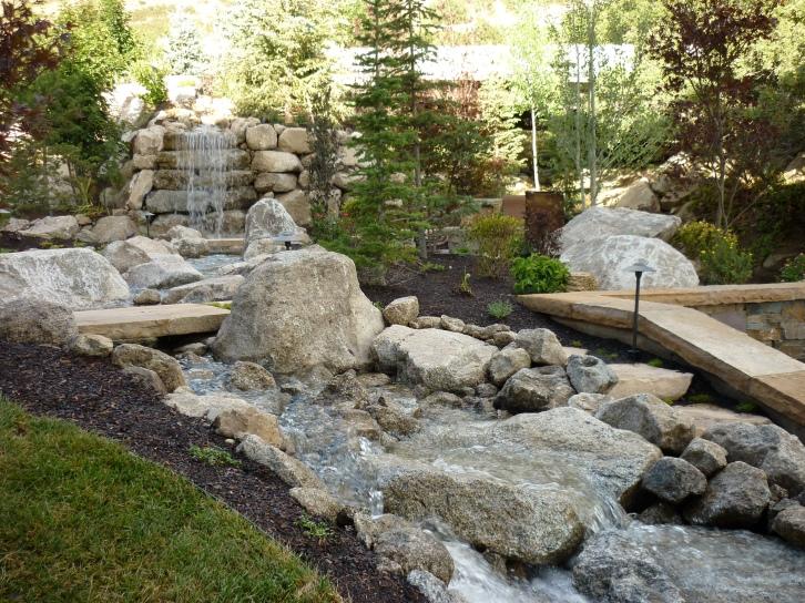Utah backyard playgrounds trampolines in the ground rock for Landscaping rocks tooele utah