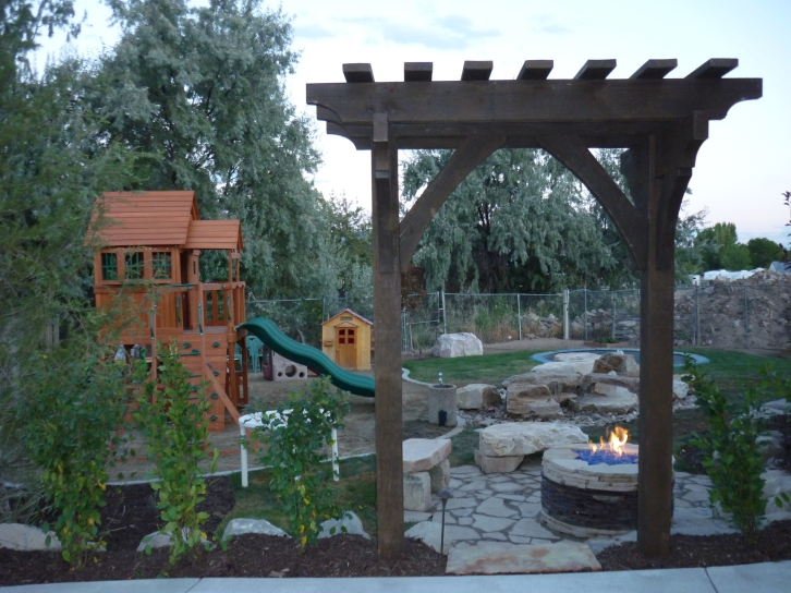 Utah backyard playgrounds, Trampolines in the ground, Rock water feature play rocks, Basketball courts, Swings, Play rocks and natural gas fire pits in Utah