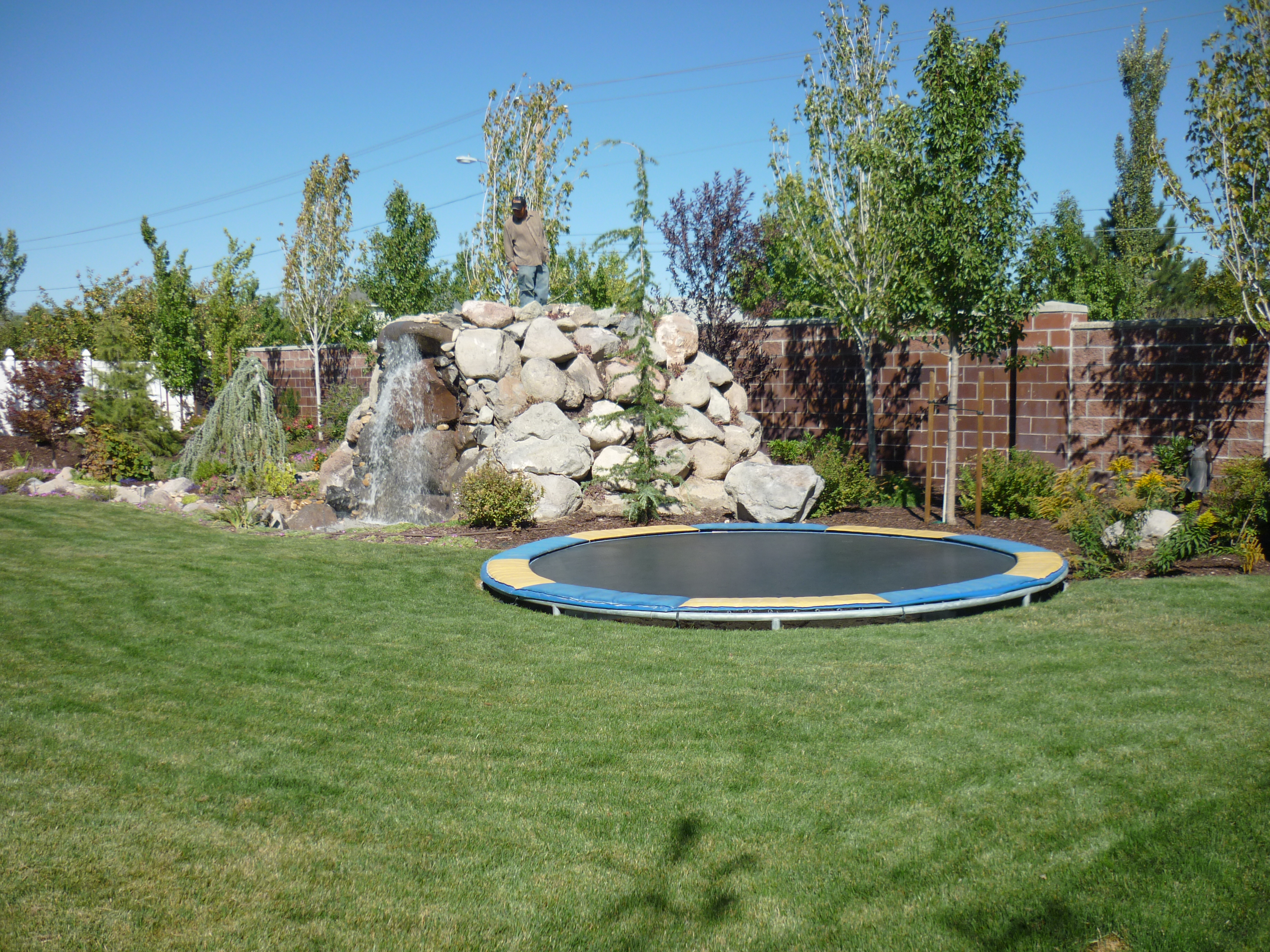 utah backyard playgrounds trampolines in the ground rock water