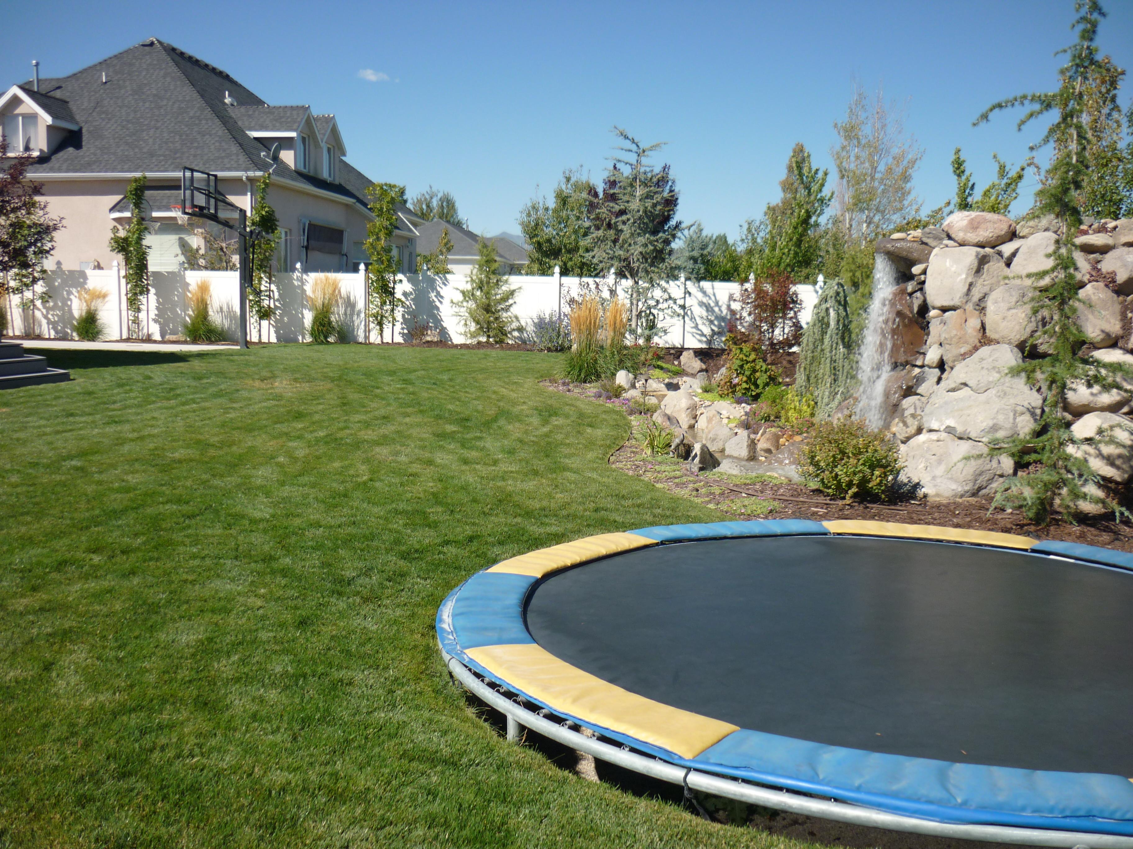 utah backyard playgrounds trampolines in the ground rock water