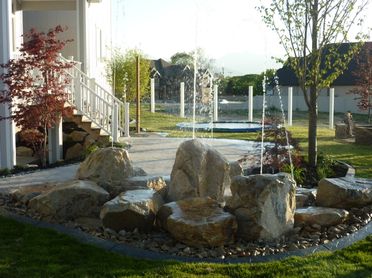 Backyard playground waterfeature and fire in utah chris for Landscaping rocks ogden utah