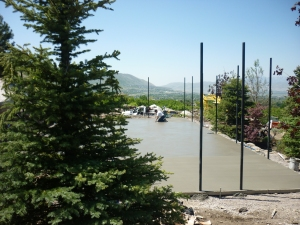 Kid friendly backyard play ground, swing set, trampoline in the ground, splash pad, splash pad rock water feature, water feature for the kids, creative kid freindly, the ultimate kids backyard, fire pit, swimming pool, jumping rock in the landscaping in Utah