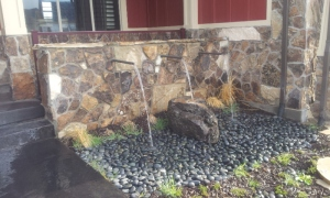 Utah landscaping with a wall water feature in the Salt lake city Parade of Homes