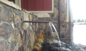 Stone wall and front entry water fountain