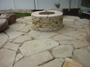 Flagstone patio, rock sitting and fire