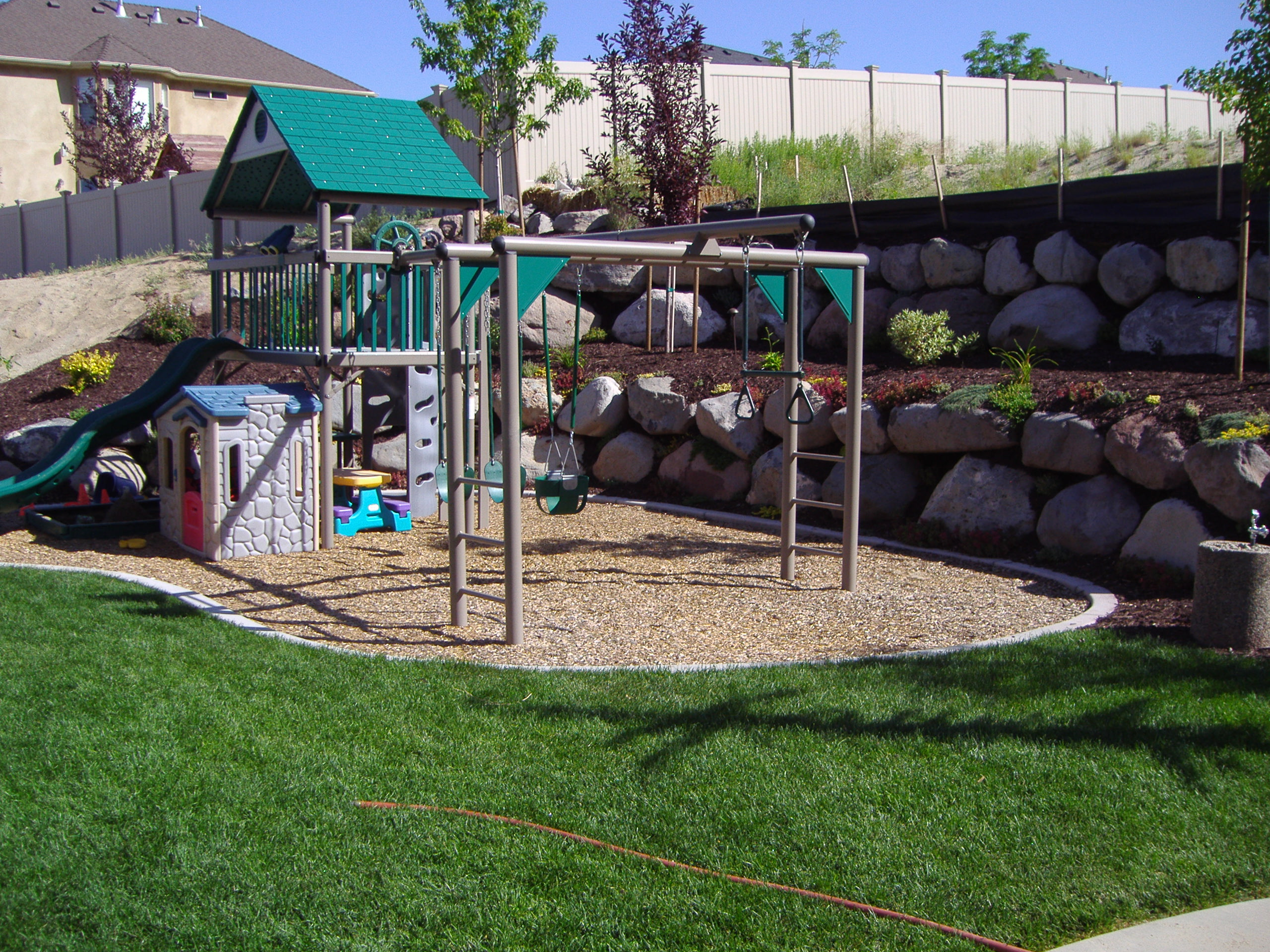 Family Friendly Backyard Ideas : Kid friendly play areas with water features, Putting greens and design