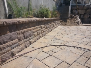 Landscaping in Bountiful Utah, landscaper installing, Huge rock boulder retaining walls, rock walls, Retaining, double pump energy efficient water features, walls, landscaping, Belgard natural gas fire pit, Belgard Mega Laffit Paver patio around the pool, Belgard Paver walls in Belair with belair caps, Paver fire pits, trees, topsoil, sod from bio grass sod farms, Landscape construction, landscaping in Bountiful, Utah, Bountiful City Landscaping In Utah, landscaping in bountiful city installing water features, water falls, fire pits, paver fire pits and patios, rock walls, steps, landscaping, landscapers, landscape contractors, landscape design, landscape installation, plants, custom landscaping