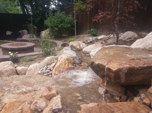 Utah landscapers, landscape, landscaping the backyard with waterfalls, swimming pool, pergolas, rock walls, trees, hammock, rock stairs, Fire pits, Gas fire pits, walls, pavers, Utah paver companies, Utah