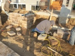 My employees working hard at work doing Belgard pavers